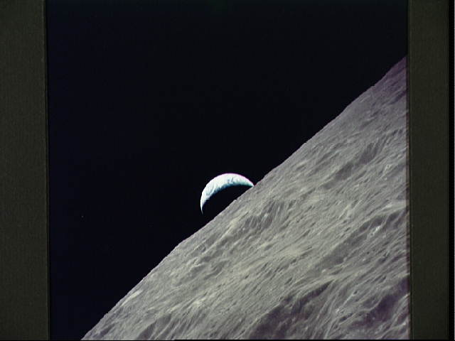 Cresent Earth rises above lunar horizon (taken by Apollo 17)