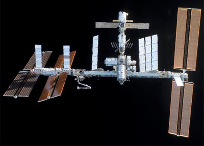 The International Space Station is viewed from space shuttle Discovery after undocking during the STS-120 mission.