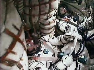 Expedition 16 Crew rockets into space inside a Soyuz capsule.