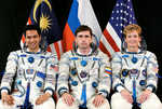 The expedition 16 crew (to the middle and right). They will replace the expedition 15 crew at the IIS. The swap must happen before STS-120 can launch.