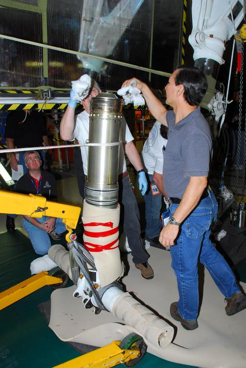 Shuttle Discovery's landing gear is being worked on. Photo Credit: NASA