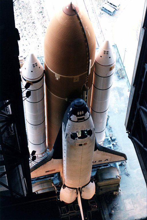 Shuttle rolls out from the VAB to the pad. This picture is from the STS-83 mission. Credit: NASA