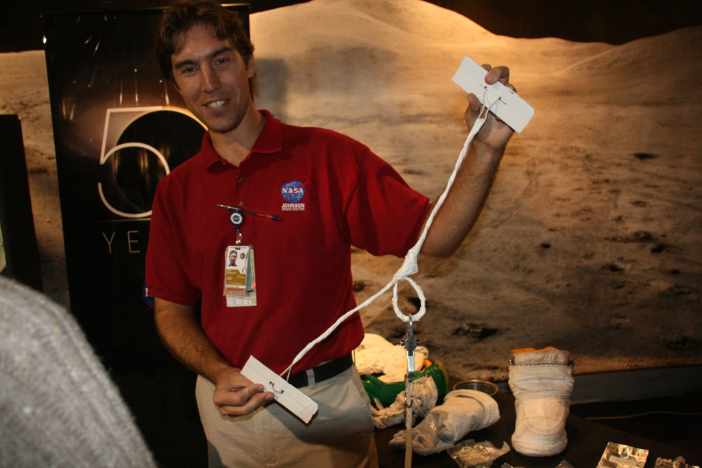 "At the World Space Expo 2007 in Kennedy Space Center, a model of the ""repair kit"" for ISS' solar arrays is demonstrated. Joe from JSC said he flew in yesterday and has assembled the part today from things he quickly got at the local hardware store (of course, in space they use somewhat different material, but you get the idea).