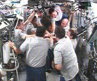 The STS-120 and Expedition 16 crew members bid farewell to each other. Image credit: NASA TV