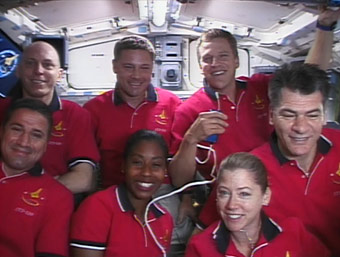 The STS-120 crew members aboard Discovery take a break from landing preparations on Tuesday to talk to reporters. Image credit: NASA TV
