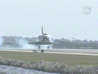 Space shuttle Discovery lands at Kennedy Space Center, Fla. Image credit: NASA TV
