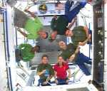 STS-120 and Expedition 16 crew members gather in the new Harmony module to talk to the press. Image credit: NASA TV