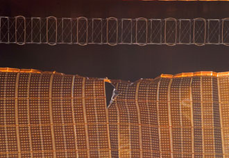STS-120 Flight Day 8: A view of a damaged P6 4B solar array wing on the International Space Station. Image credit: NASA TV