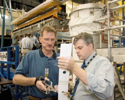 Astronaut Joseph R. Tanner, left, works with David H. Mothers of USA on possible ISS solar array repair procedures to be used by STS-120 spacewalkers.<br />Photo Credit: NASA