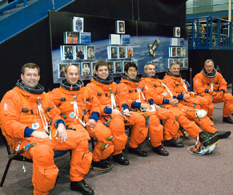 Attired in training versions of their shuttle launch and entry suits, the STS-123 crew members await the start of a training session in the Space Vehicle Mockup Facility at Johnson Space Center. From the right are astronauts Dominic L. Gorie, commander; Gregory H. Johnson, pilot; Richard M. Linnehan, Japan Aerospace Exploration Agency's (JAXA) Takao Doi, Robert L. Behnken, all mission specialists; Garrett E. Reisman, Expedition 16 flight engineer; and Michael J. Foreman, mission specialist. Image credit: NASA